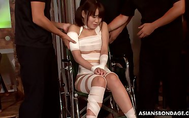 Tied up slender Japanese nympho Nene Masaki is mouthfucked hard by two dudes
