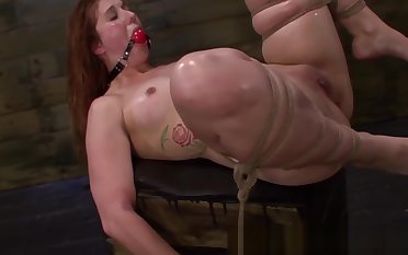 BDSM redhead bitch straponfucked closeup
