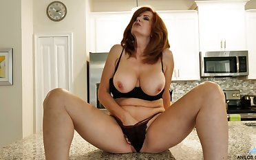 Red haired MILF undresses and plays not far from their way appetizing chubby boobies